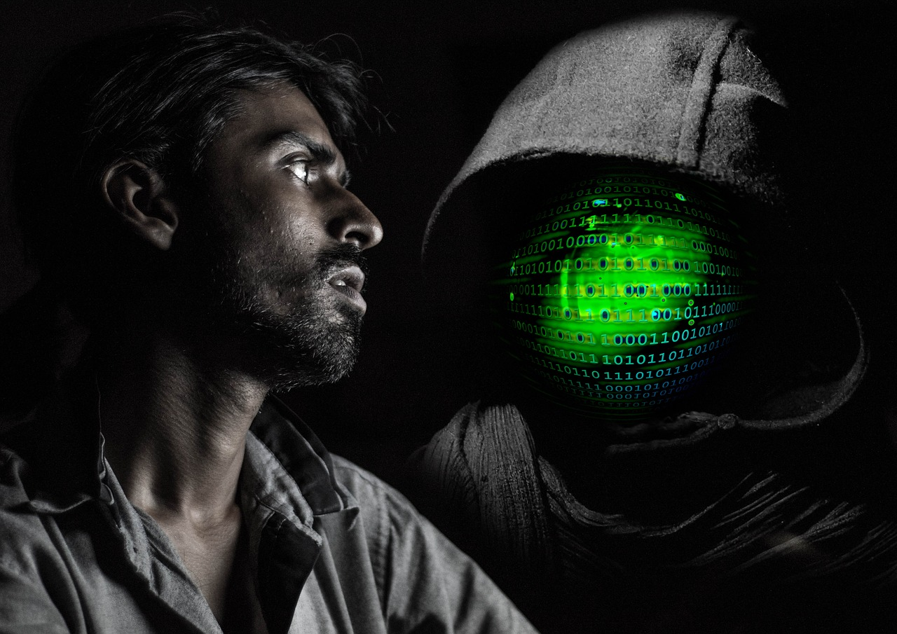 man afraid hacker hooded
